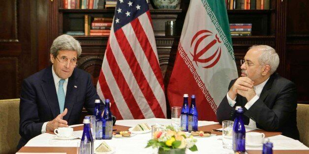 U.S. Secretary of State John Kerry, left, speaks to the media as Iranian Foreign Minister Mohammad Javad Zarif listens Friday, April 22, 2016, in New York. (AP Photo/Frank Franklin II)