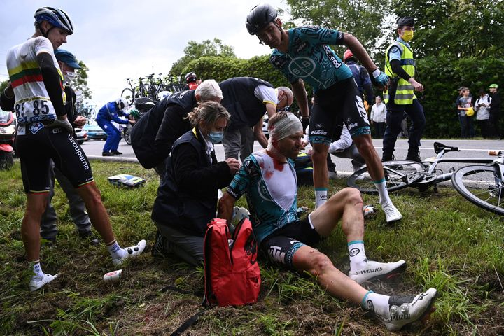 Cyril Lemoine of France is helped by medical staff members after one of Saturday's horrific crashes.