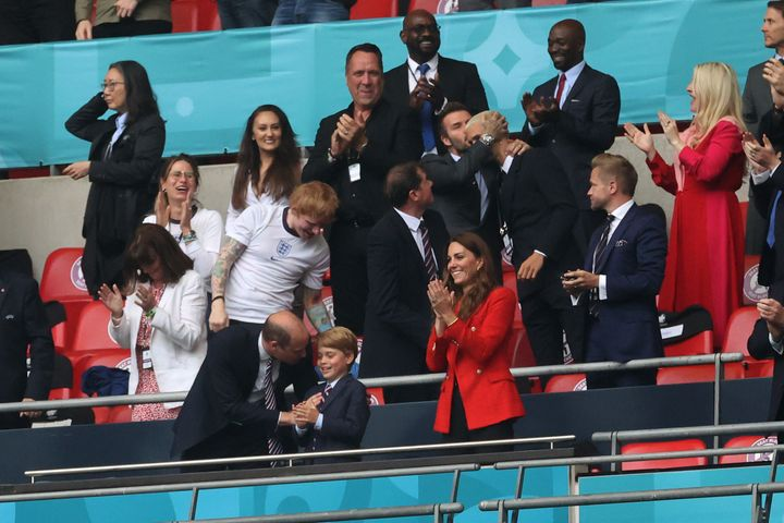 Ed Sheeran and David Beckham sit in the stands alongside the royals.