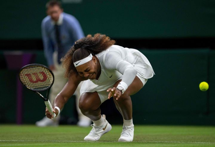 Serena Williams winces in pain before she eventually withdrew from the match.