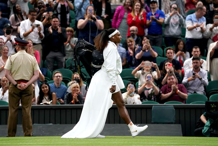 Serena Williams made a grand entrance onto Wimbledon's Centre Court wearing a removable train.