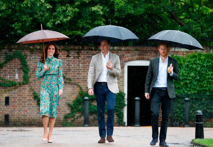 Princes William and Harry, with Kate Middleton, at the memorial gardens in Kensington Palace on Aug. 30, 2017.