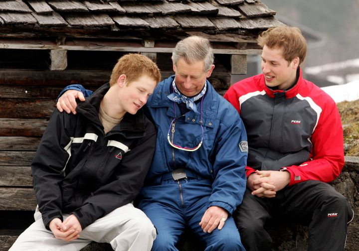The boys with their father Prince Charles during a 2005 ski trip in Switzerland.