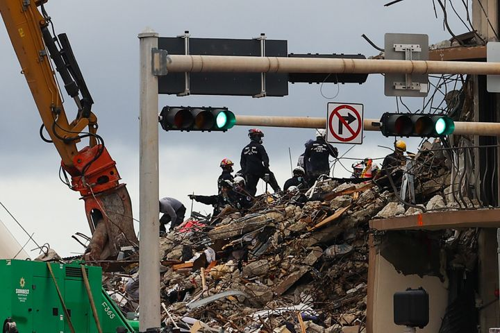 A team of rescue workers searches through the rubble of theChamplain Towers South building in Surfside, Florida, which