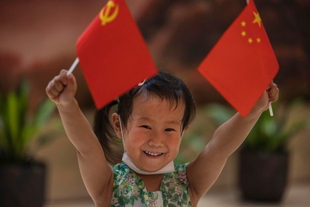 epa09314817 A girl vases flags in the Memorial of the 1st National Congress of the CPC (Chinese Communist...