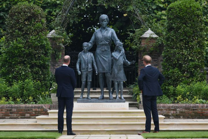 The Duke of Cambridge (left) and Duke of Sussex with the statue they commissioned of their mother.