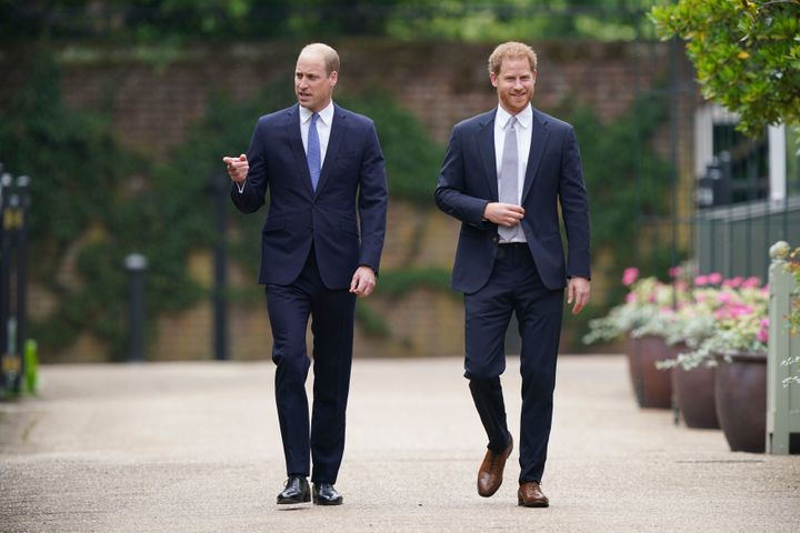 Princes William and Harry unveil a statue of their mother, Princess Diana, at the Sunken Garden in Kensington Palace on July