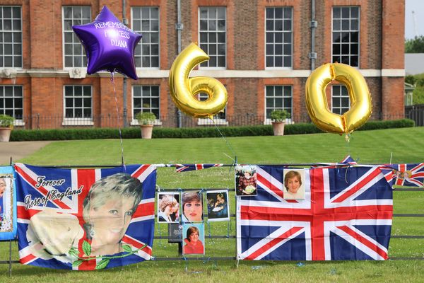 Flowers and tributes to Princess Diana are seen outside the Golden Gates at Kensington Palace on Thursday in London.
