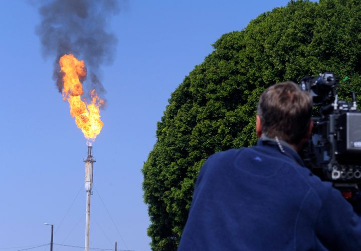 Flames leap from a burner unit after an explosion at the Exxon Mobil refinery in Torrance, California.