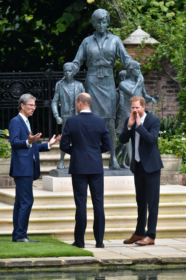 Rank-Broadley speaks with the Duke of Cambridge, while Harry shouts for someone.
