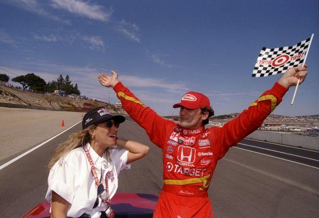 7 Sep 1997: Alex Zanardi of Italy celebrates with his wife Daniella during the Toyota Grand Prix of Monterey...