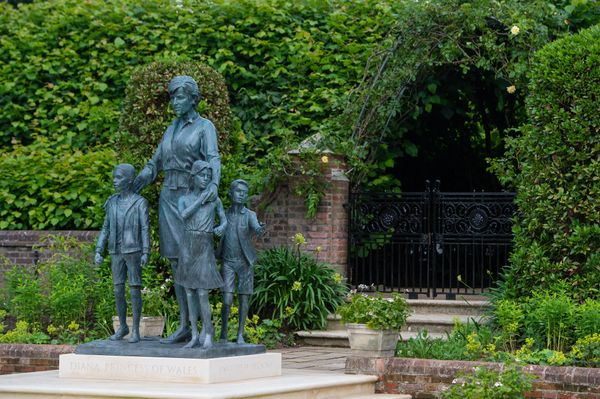 """A better look at the three children that surround the Princess Diana statue. Kensington Palace said that the children """"repres"""