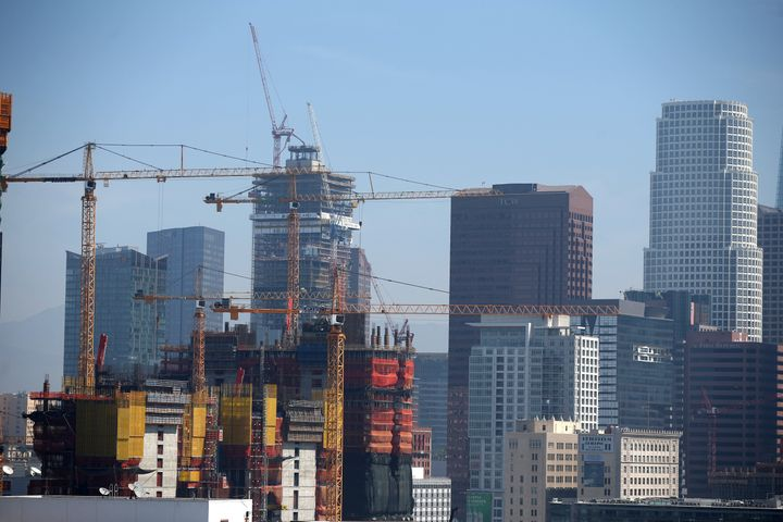Construction cranes are seen in downtown Los Angeles.
