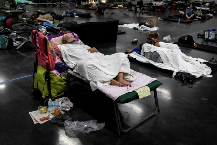 People sleep at a cooling shelter set up during an unprecedented heat wave in Portland, Oregon, on June 27.