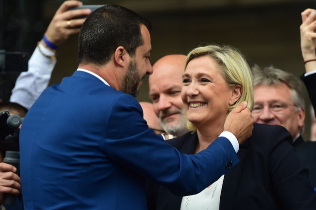 MILAN, ITALY - MAY 18: (L - R) Leader of Northern League party, Matteo Salvini embraces Marine Le Pen...