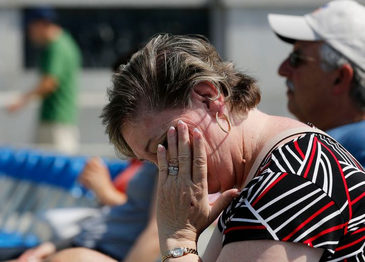 A Maryland woman wipes sweat off her face during a heat wave in Washington, D.C.
