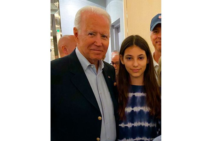 In this photo provided by a family member, 12-year-old Elisheva Cohen poses with President Joe Biden, Thursday, July 1, 2021,