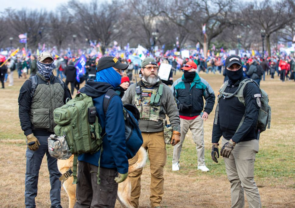 """Members of the Oath Keepers wearing military tactical gear attend the """"Stop the Steal"""" rally on Jan. 6 prior to the storming"""