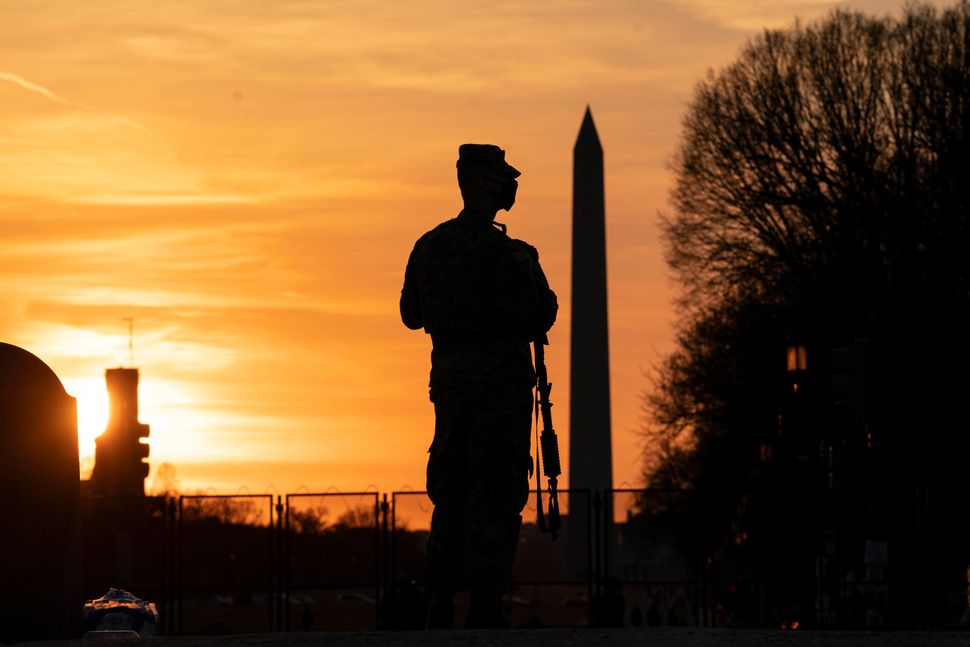 A member of the National Guard patrols outside the U.S. Capitol on March 8.