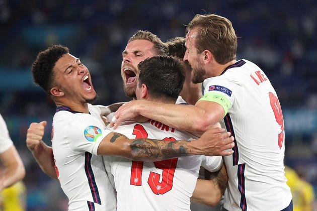 Jordan Henderson of England celebrates with Jadon Sancho, Mason Mount and Harry Kane after scoring their...