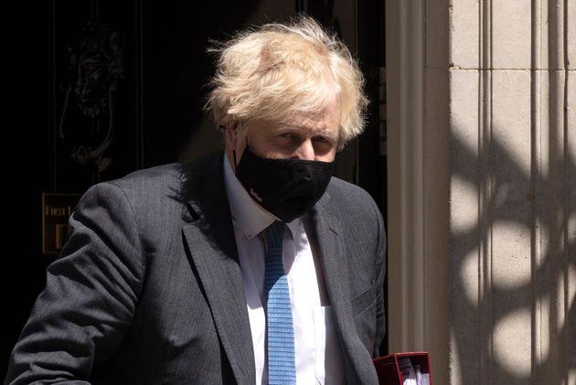 LONDON, ENGLAND - JUNE 23: British Prime Minister, Boris Johnson wearing a face mask, leaves 10 Downing...