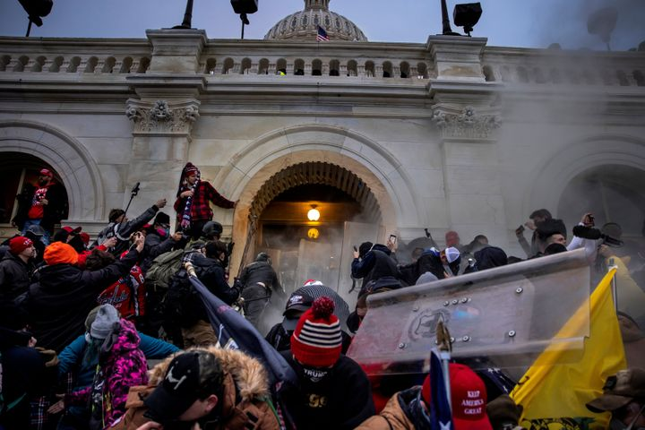 WASHINGTON, DC - JANUARY 6: Trump supporters clash with police and security forces as people try to storm the US Capitol on J