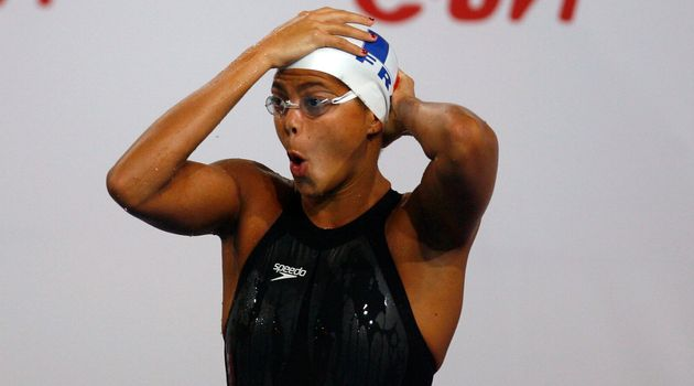 Coralie Balmy of France adjusts her cap before the start of women's 400m freestyle final at the European...