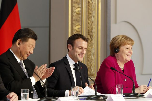 epa07464284 French President Emmanuel Macron, (C), Chinese President Xi Jinping (L) and German Chancellor...