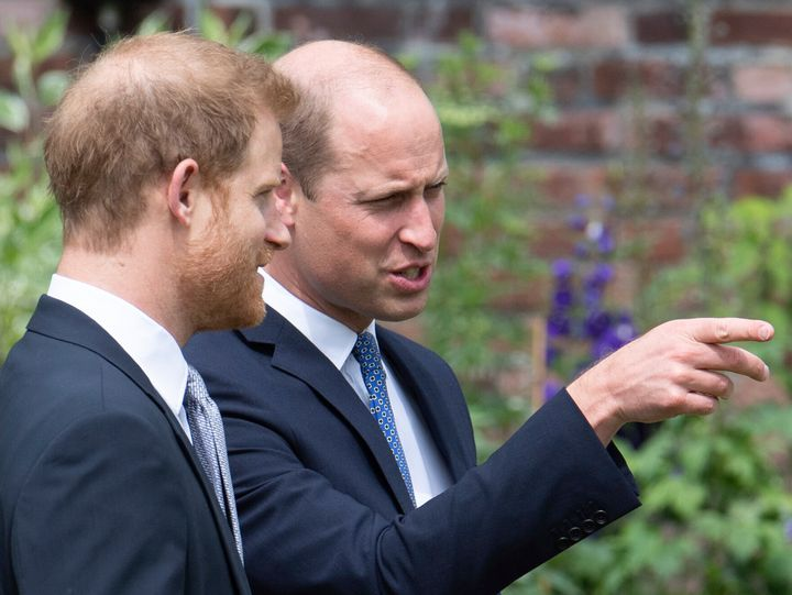 Britain's Prince William and Prince Harry appear together for the unveiling of a statue they commissioned from their mother Pri