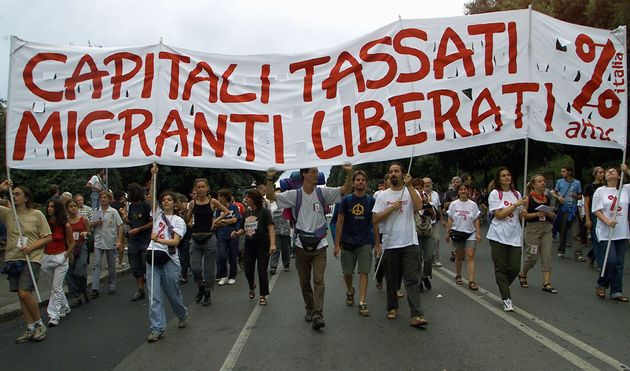 GEN14-20010719-GENOA, ITALY: Demonstrators carry a placard reading