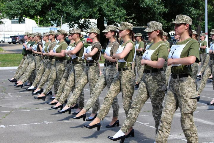 Ukraine's defense minister is under pressure from members of the government over the decision to have female military c