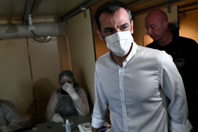 French Health Minister Olivier Veran visits a Covid-19 screening test facility set up at the 23rd edition...