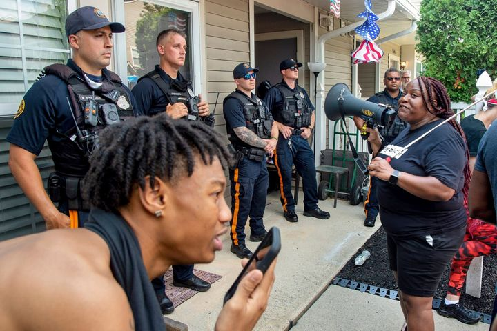 Shanta Smith, right, confronts police outside Mathews' home on Monday. Mathews was filmed Friday confronting a Black ne