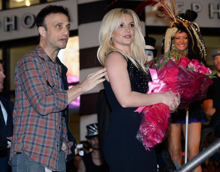 Larry Rudolph (left) and Britney Spears in 2013.