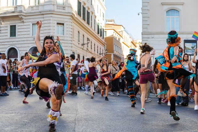 ROME, ITALY - 2021/06/26: People dance during the universal demonstration in celebration of Rome Pride...
