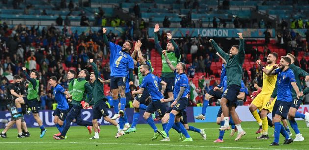 Italy's players celebrate after winning the UEFA EURO 2020 semi-final football match between Italy and...
