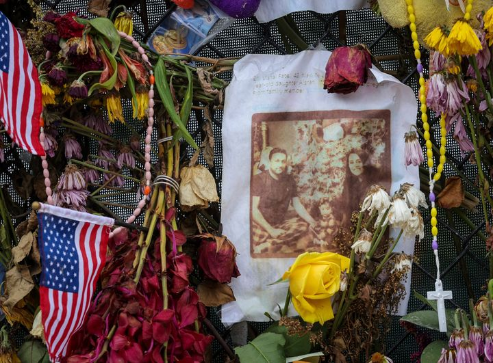 Flowers surround photos of the decease and missing before a burial service at St. Joseph Catholic Church in Miami Beach on Tu