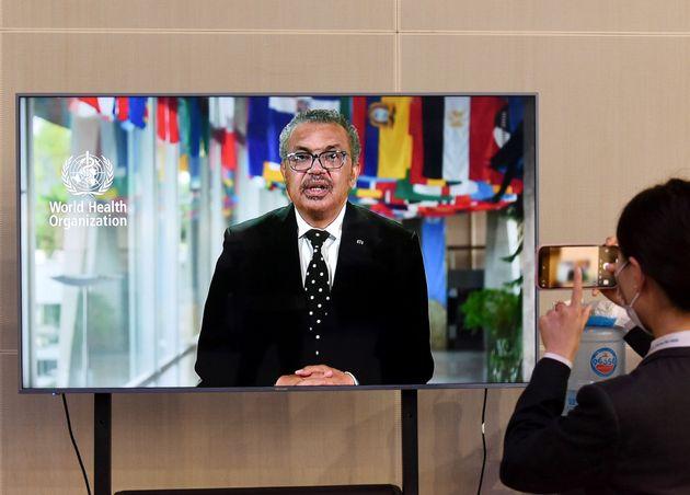 Tedros Adhanom Ghebreyesus, director-general of the World Health Organization, delivers a speech via...