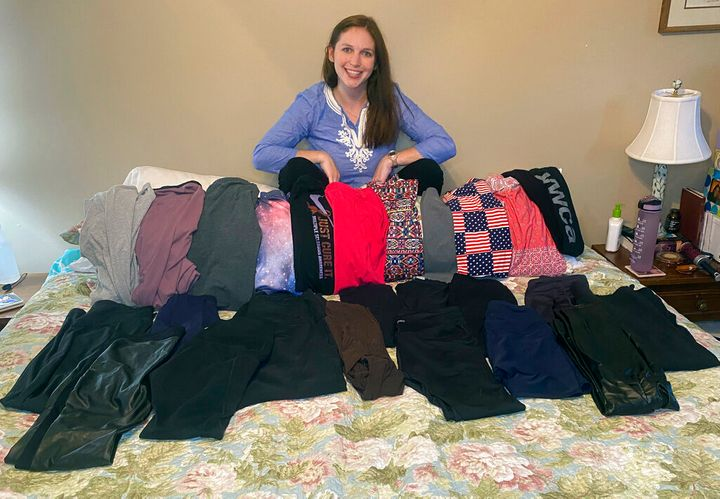 This photo shows Cameron Howe at home in Lynchburg, Va., on June 28, 2021, with her collection of leggings purchased during the pandemic. She hopes to continue wearing leggings as business attire as she transitions back to work, while others are purging their casual pandemic wardrobes. (Cameron Howe via AP)