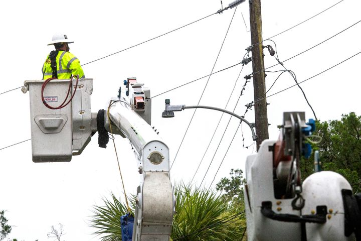 Power crews work to restore power after Tropical Storm Elsa made landfall on July 7, 2021 in Cedar Key, Florida.