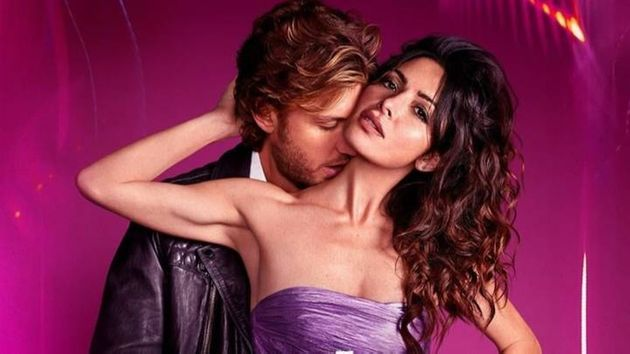 Brad and Billie (Adam Demos and Sarah Shahi) in