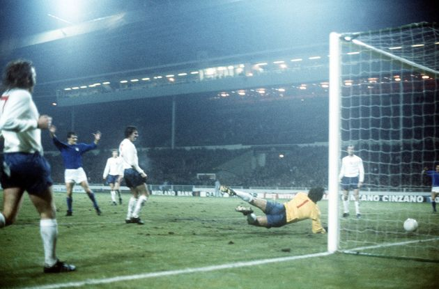 Italy's Fabio Capello (left, arms raised) scores the only goal of the England v Italy international match...