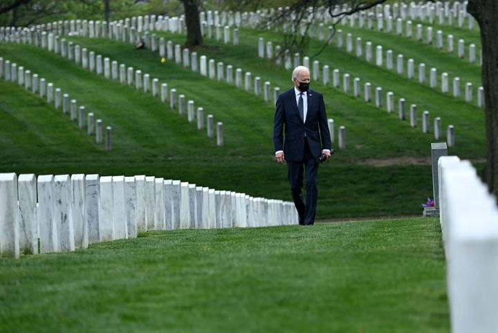"""Biden walking through Arlington National Cemetery on April 14. He said at the time that it was """"time to end"""" America's longes"""