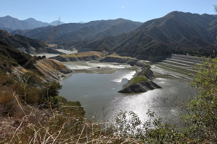 Photo taken on June 24, 2021 shows rocky shores and dust lake bed exposed at the San Gabriel Reservoir near Azusa, Los Angeles County, California, the United States.
