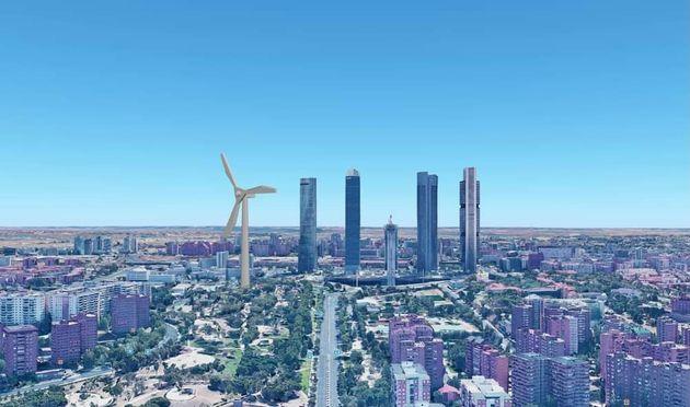 Recreación del tamaño de un molino de viento junto a los cuatro rascacielos de