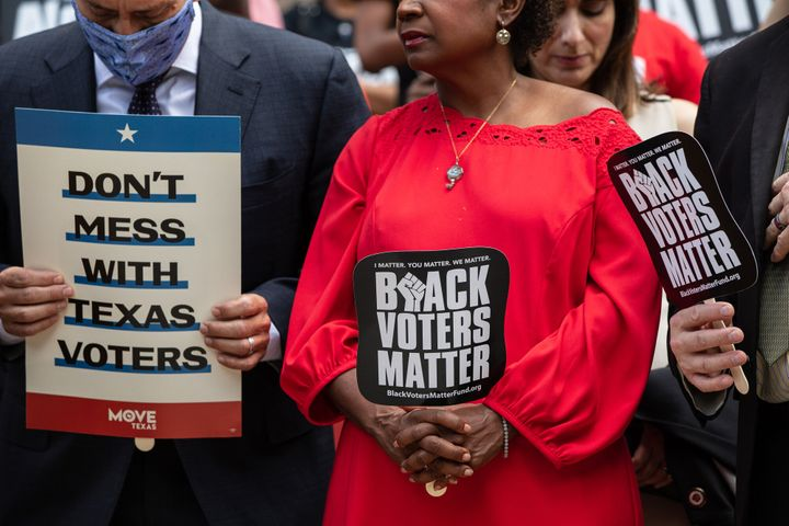 Members of the Texas House Democratic Caucus take part in a voting rights rally outside of the Texas State Capitol on July 8.