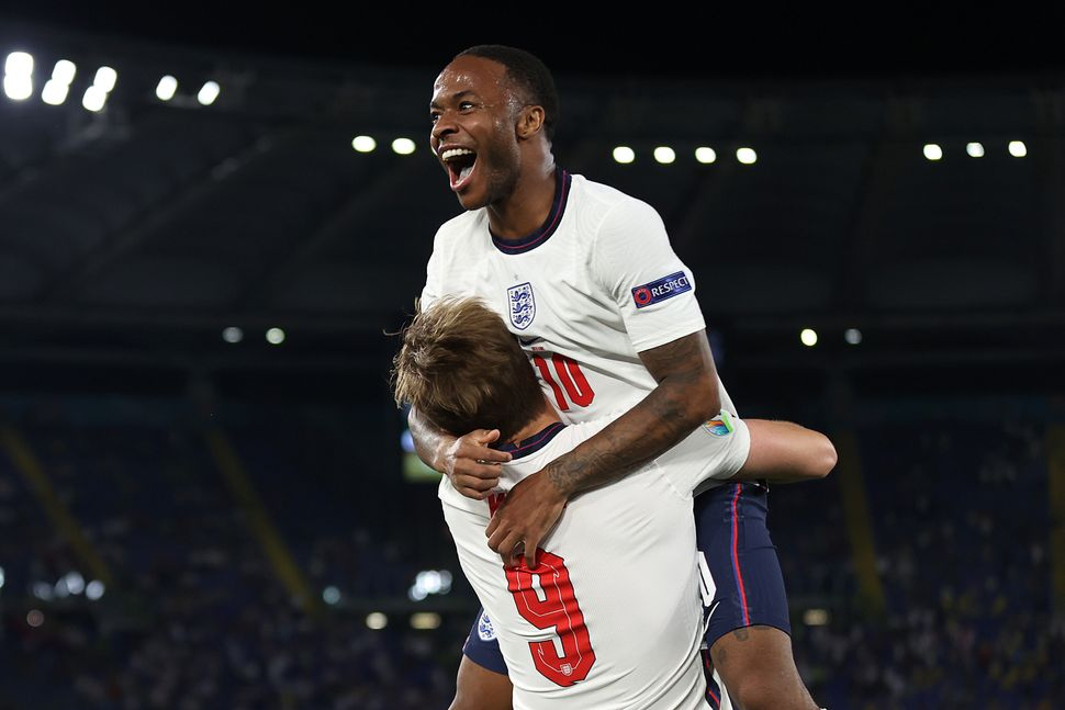 Raheem Sterling and teammate Harry Kane after victory against Ukraine in the quarter-finals.