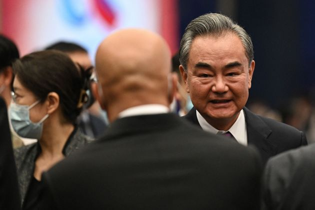 Chinese Foreign Minister Wang Yi (R) chats with guests after the opening ceremony of the Lanting Forum...