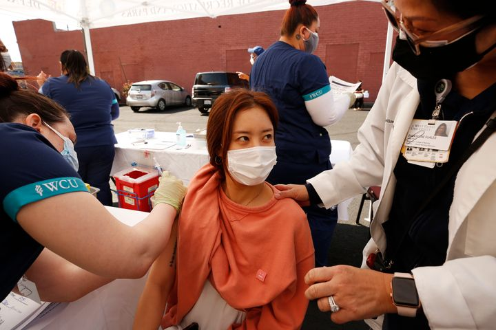 Luna Paik receives the Pfizer COVID-19 vaccination from student registered nurse Briana Shaw in Los Angeles on April 20.