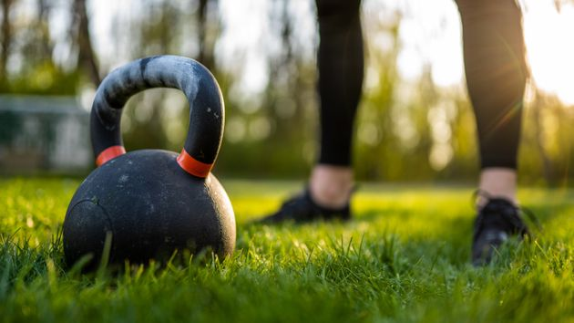 Close up of kettlebell on grass in sunset